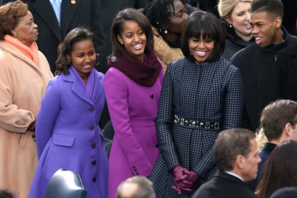 First lady Michelle Obama and daughters, Sasha Obama and Malia Obama arrive during the presidential inauguration.