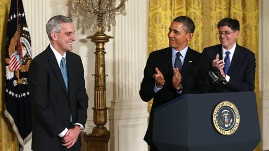 President Barack Obama (C) and White House Chief of Staff Jack Lew (R) applaud as Deputy National Security Adviser Denis McDonough (L) look on during a personnel announcement at the East Room of the White House