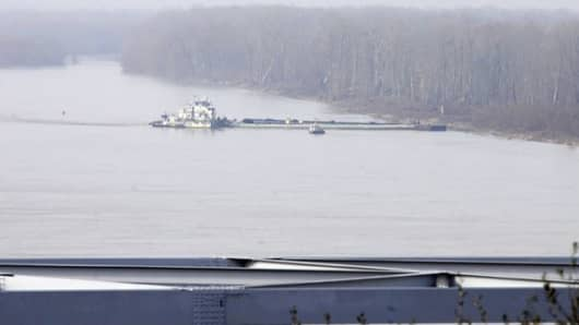 Oil spills out of a barge near Vicksburg, Miss. on Monday, Jan. 28, 2013.