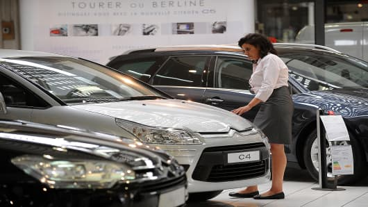Hasna Hourri looks at Citroen cars at a Citroen showroom in Paris, France.