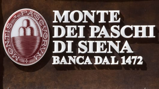 The Monte dei Paschi di Siena SpA logo is seen on one of the bank's branches in Rome, Italy.