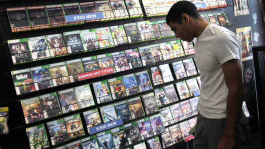 A customer shops for a video game to purchase.