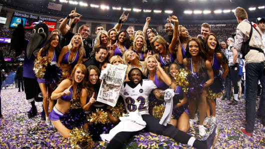 Torrey Smith of the Baltimore Ravens celebrates with the Ravens cheerleaders after winning Super Bowl XLVII.