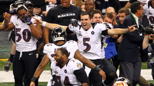Joe Flacco #5 of the Baltimore Ravens celebreates with his teammates after defeating the San Francisco 49ers during Super Bowl XLVII.