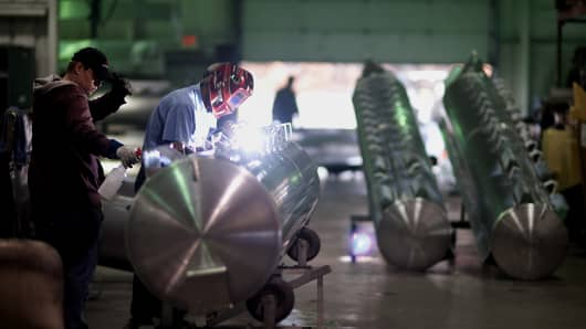 An employee welds mounting brackets to an aluminum pontoon during the fabrication process at the Nautic Global Group production facility in Elkhart, Indiana, U.S.