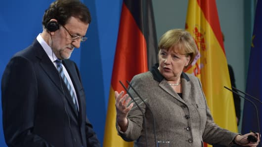 German Chancellor Angela Merkel and Spain's Prime Minister Mariano Rajoy address a press conference at the Chancellery in Berlin on February 4, 2013 after their meeting.