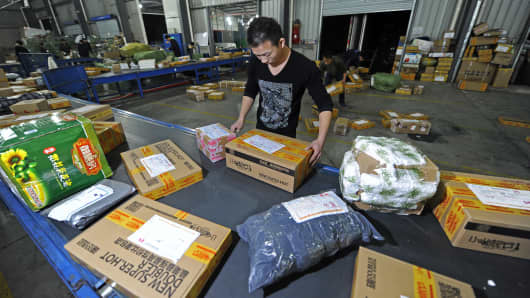 Workers distribute packs at an express company in November  in Wuhan, China. Tmall.com and Taobao.com are China's biggest online shopping sites of Chinese e-commerce giant Alibaba Group Holding.