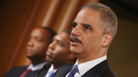 U.S. Attorney General Eric Holder leads a news conference with Acting Associate Attorney General Tony West, Principal Deputy Assistant Attorney General Stuart Delery and attorneys general from eight states and the District of Columbia at the Department of Justice.