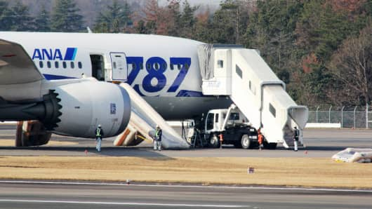 Dreamliner operated by All Nippon Airways (ANA) sits on the tarmac after an emergency landing at Takamatsu Airport.