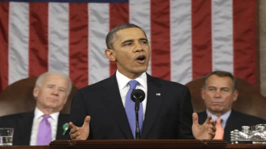 U.S. President Barack Obama, flanked by Vice President Joe Biden and House Speaker John Boehner, delivers the State of the Union address on February 12, 2013 in Washington, D.C.