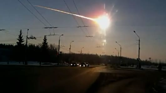 A meteor crashing in central Russia's Ural mountains.