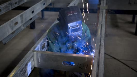 A Capsys Corp. employee, MIG welds a steel frame for a modular housing unit at the Brooklyn Navy Yard in the Brooklyn borough of New York, U.S.