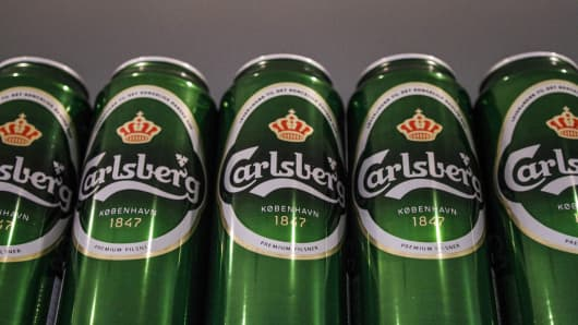 Cans of Carlsberg beer stand on display at the company's store at the headquarters of Carlsberg A/S in Copenhagen, Denmark.