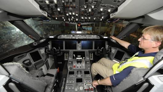 A flight test engineer of Boeing sits on 787 Dreamliner cockpit.