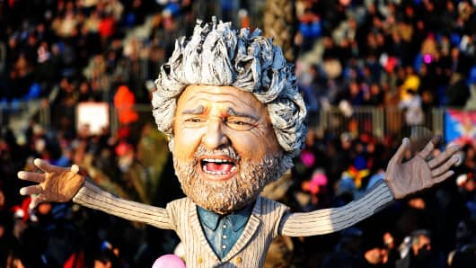 A giant paper mache float representing Italian comedian and politician Beppe Grillo moves through the streets of Viareggio, Italy.