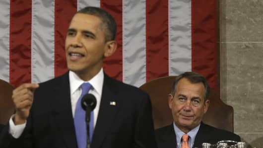 House Speaker John Boehner listens as President Obama gives his 2013 State of the Union address.