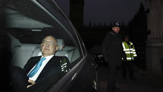 Argentinian Foreign Minister Hector Timerman leaves in a car from Britain's Houses of Parliament in London, on February 5, 2013.