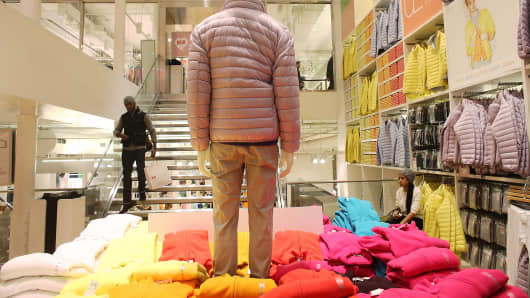 A man carries a shopping bag in a Uniqlo store in Manhattan in New York City