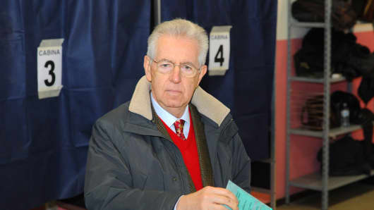 Prime Minister Mario Monti casts his vote in a polling station on February 24, 2013 in Milan, Italy.