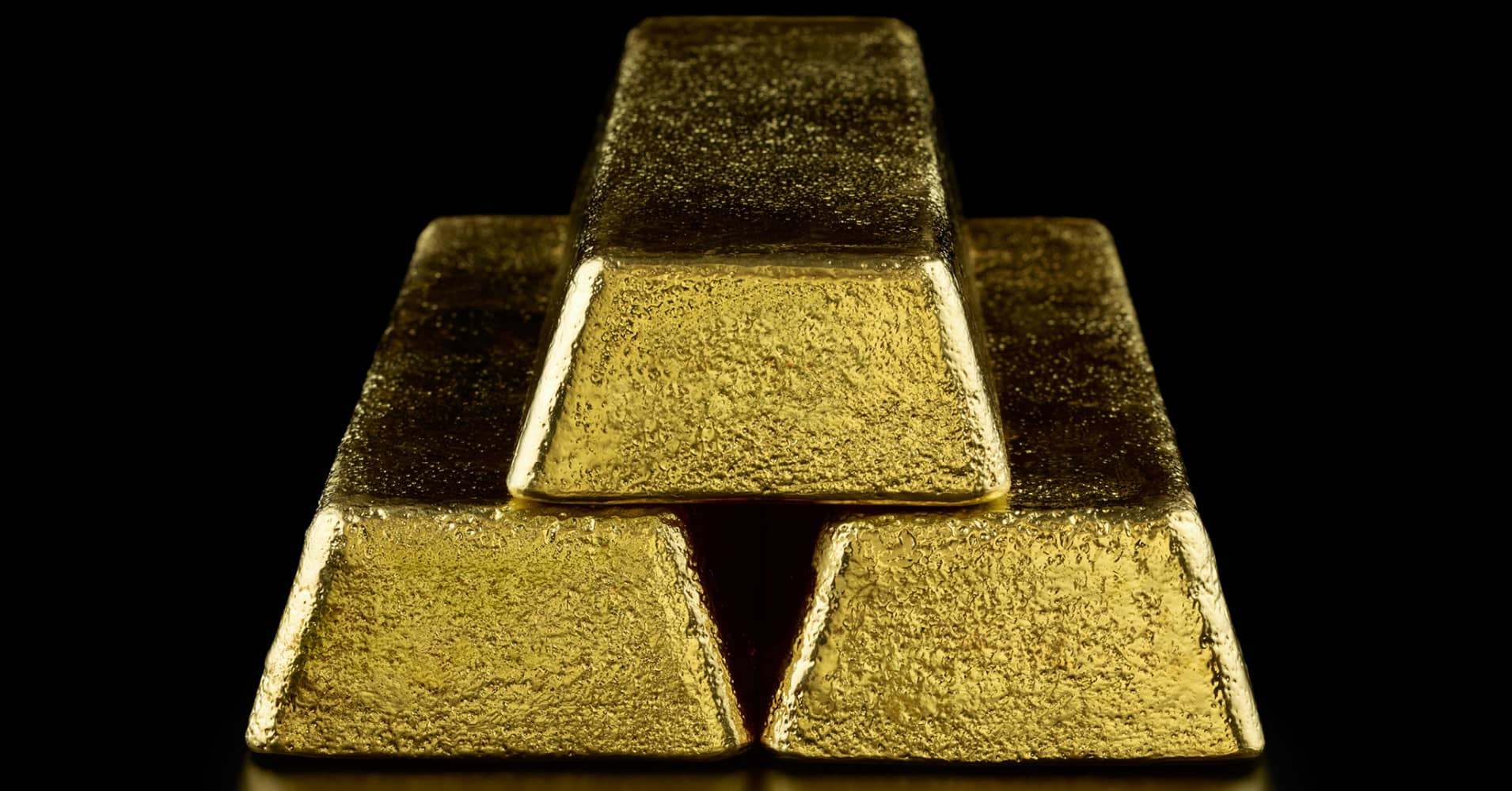 Gold inches down as greenback firms against the yuan