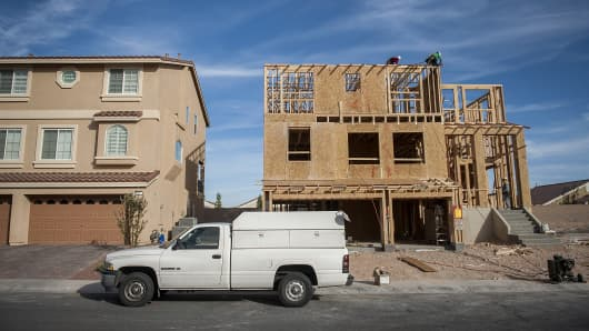 A recently constructed home stands next to a home under construction in Las Vegas, Nevada, U.S.