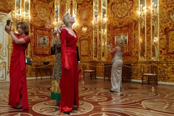 Guests view the Amber Room of Ekaterininsky Palace in Pushkin, Russia.