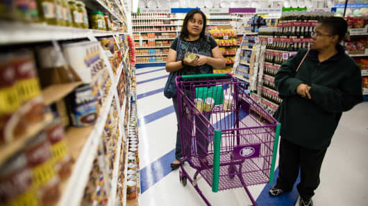 Crystal Dupont and her mother, Regina Dupont-Williams, shop for inexpensive groceries at a dollar store.