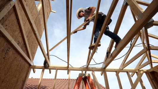 A worker builds a new home in Phoenix, Arizona.