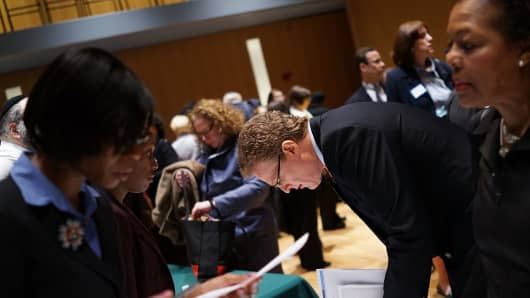 Job seekers speak to representatives of employers at a job fair at the Jewish Community Center in Manhattan, New York City.