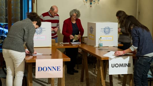 Members of a polling station count the ballot papers after the closure of the polls for the Italian General Election.