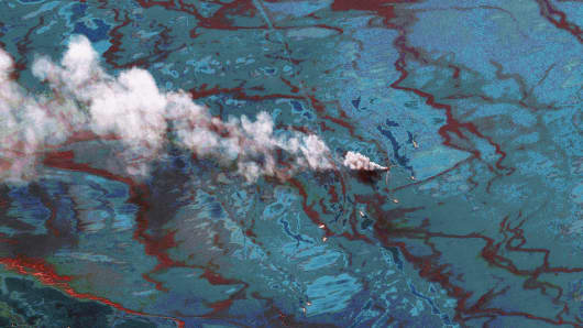 In this satellite image, vessels are seen at the site of the oil spill June 15, 2010 in the Gulf of Mexio.