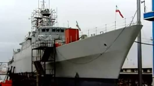 Iran launches its new Jamaran-2 guided missile destroyer.