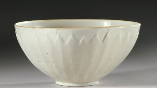 A rare and important 'Ding' Bowl from the Northern Song Dynasty bought at a garage sale for $3 dollars, sells at auction for $2.25 million at Sotheby's, New York.
