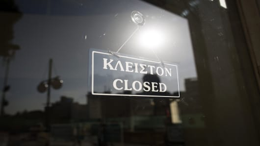 A closed sign hangs in the window of a Bank of Cyprus Plc branch in Nicosia, Cyprus, on Wednesday.
