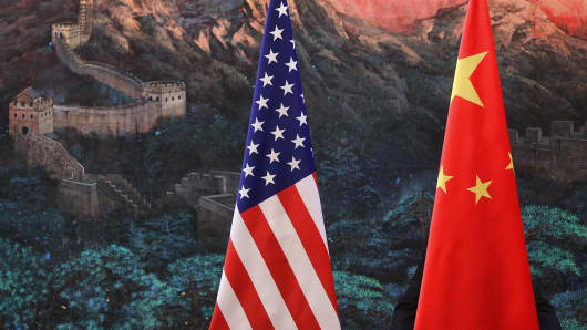 The national flags of the U.S. and China.