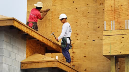 Construction workers build a Toll Brothers Inc. home in the Azura community in Boca Raton, Florida.