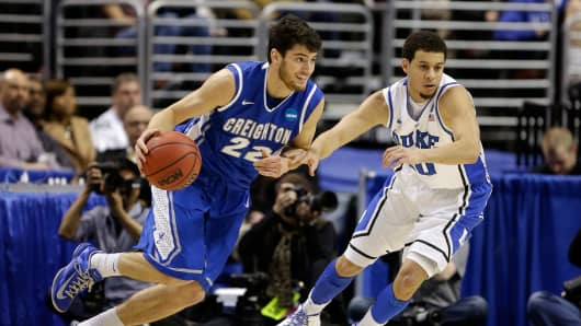 Avery Dingman #22 of the Creighton Bluejays drives on Seth Curry #30 of the Duke Blue Devils.