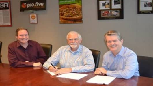 L. Gale Lemerand signs franchise agreement with Randy Gier,