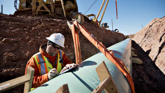 A weld inspector during construction of the Gulf Coast pipeline in Prague, Okla.