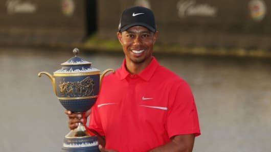 Tiger Woods poses after victory at the World Golf Championships-Cadillac Championship at the Trump Doral Golf Resort & Spa.