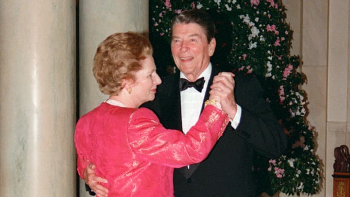 British Prime Minister Margaret Thatcher dances with US President Ronald Reagan 16 November 1988 following a state dinner given in her honor at the White House.