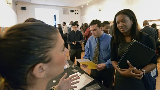 Job seekers speak with recruiters at the NYC Restaurant Job Expo at the Gabarron Foundation in New York, U.S., on Tuesday, April 9th, 2013.