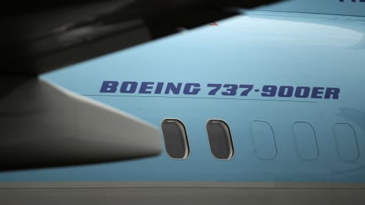 A Boeing Co. 737-900ER aircraft sits on display on the first day of the Farnborough International Air Show in Farnborough, U.K.