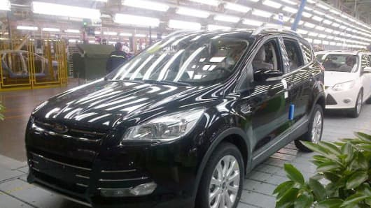 A Ford Kuga rolls off the assembly line at the Ford plant in Chongqing, China.