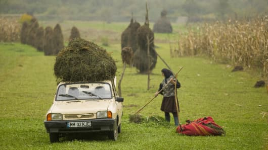 Romania, Maramures, Dacia car loaded with hay