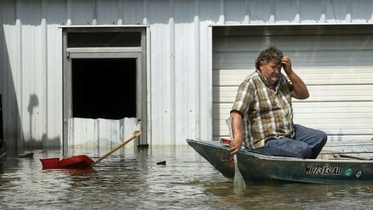 A man attempts to retrieve belongings from his flooded home along the Yazoo River near Yazoo City back in May 22, 2011 in Yazoo County, Mississippi.