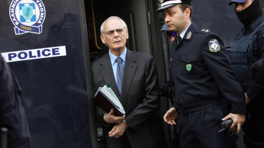 Greek former defence minister, Akis Tsohatzopoulos, arrives for a court trial in Athens on April 22, 2013.