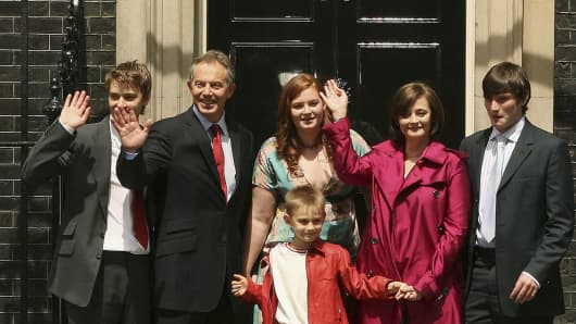 Former Prime Minister Tony Blair (2L) stands with his family (L-R) Euan, Kathryn, Leo, Cherie and Nicholas.