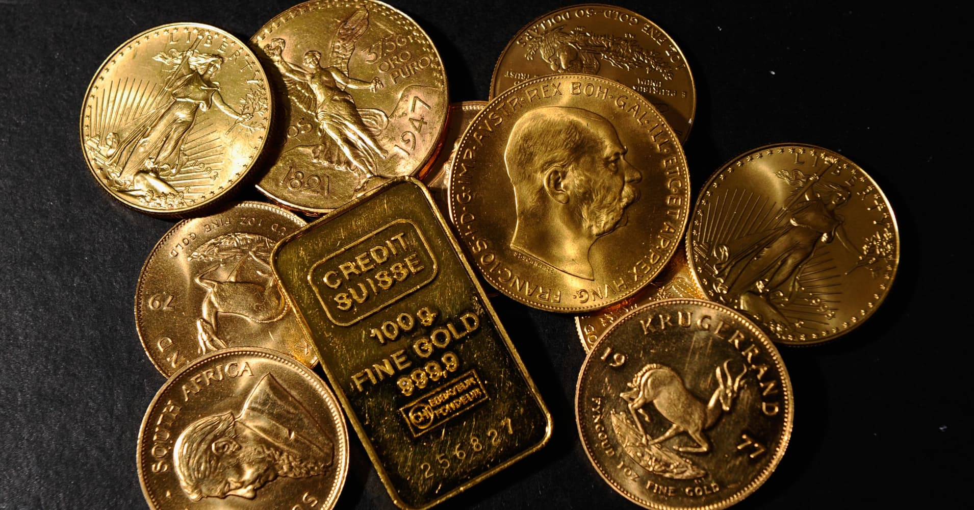 Gold inches higher as dollar dips amid risk aversion