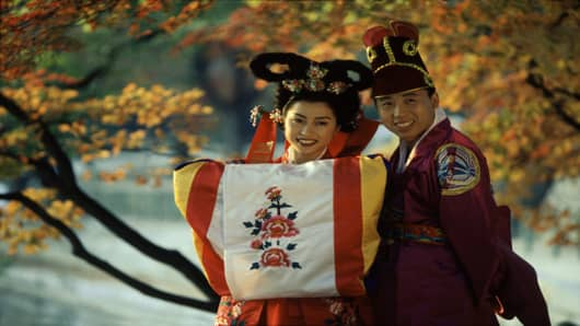 Wedding couple wearing traditional Korean costumes.